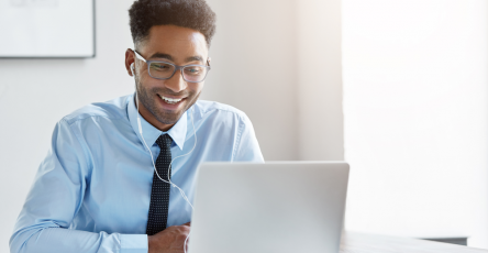 confident-businessman-working-his-laptop
